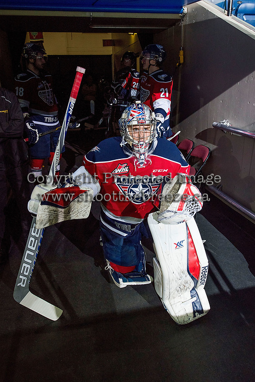KELOWNA, CANADA - MARCH 28: Eric Comrie #1 of Tri-City Americans kneels in the tunnel outside the dressing room and mentally prepares to enter the ice against the Kelowna Rockets on March 28, 2015 at Prospera Place in Kelowna, British Columbia, Canada.  (Photo by Marissa Baecker/Getty Images)  *** Local Caption *** Eric Comrie;