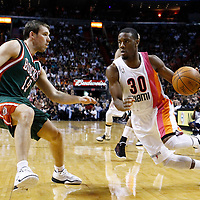 22 January 2012: Miami Heat point guard Norris Cole (30) drives past Milwaukee Bucks point guard Beno Udrih (19) during the Milwaukee Bucks 91-82 victory over the Miami Heat at the AmericanAirlines Arena, Miami, Florida, USA.