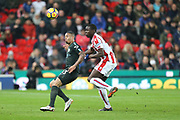 Gabriel Jesus and Badou Ndiaye during the Premier League match between Stoke City and Manchester City at the Bet365 Stadium, Stoke-on-Trent, England on 12 March 2018. Picture by Graham Holt.