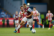Ben Gibson of Burnley  shields the ball from Will Grigg of Sunderland during the EFL Cup match between Burnley and Sunderland at Turf Moor, Burnley, England on 28 August 2019.