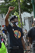 """6/6/2020 Jackson MS. <br /> Pictured is Barbara Walker with her knee on the neck of National Black Panther Party Kelvin Bradfield out side the Governor Mansion after a peaceful protest by Black Lives Matter, organized by 18yr old student Maisie Brown. Bradfield chanted """"I can't breathe """" as the crown chanted _check his pulse.""""as Walker held her knee on his neck in the 90 degree heat. Photo© Suzi Altman<br /> <br /> Student Maisie Brown 18yrs old from Jackson organized a peaceful protest outside the Governors Mansion. She said there voices would be heard and her face would be seen- change is coming. The protest was in honor of George Floyd and in support of ending systematic racism and to end police brutality in Mississippi and America. The National Black Panthers Party from Tupelo Mississippi showed up outside the Governors mansion in the shadow of the State Capitol to protest police brutality. The National Black Panthers Party was their to show their support for change in Mississippi, to end systemic racism and police brutality. Protests have broken out around the world in solidarity to end white supremacy and police brutality. The Panthers showed up at the end of a peaceful protest organized by 18yr old student Maisie Brown. The brutal murder of African American George Floyd by the knee and hands of 4 former Minneapolis Minnesota police officers has sparked a cry for justice and reform around the world. Photo copyright © Suzi Altman @suzialtman #mississippi #blm #blacklivesmatter #protest #icantbreathe #georgefloyd #endracism #policebrutality #documentary #history #suzialtman #iphonography #shotoniphone #zumapress #NBPP #panthers #blackpanthers #nationalblackpantherparty"""