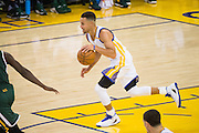 Golden State Warriors guard Stephen Curry (30) pushes the ball down court against the Utah Jazz at Oracle Arena in Oakland, Calif., on December 20, 2016. (Stan Olszewski/Special to S.F. Examiner)
