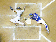 Miami Marlins' Dee Gordon slides safely past Milwaukee Brewers catcher Jonathan Lucroy during the fifth inning of a baseball game Monday, Aug. 17, 2015, in Milwaukee. Gordon scored from third on a sacrifice fly by Martin Prado. Miami won 6-2. (AP Photo/Morry Gash)