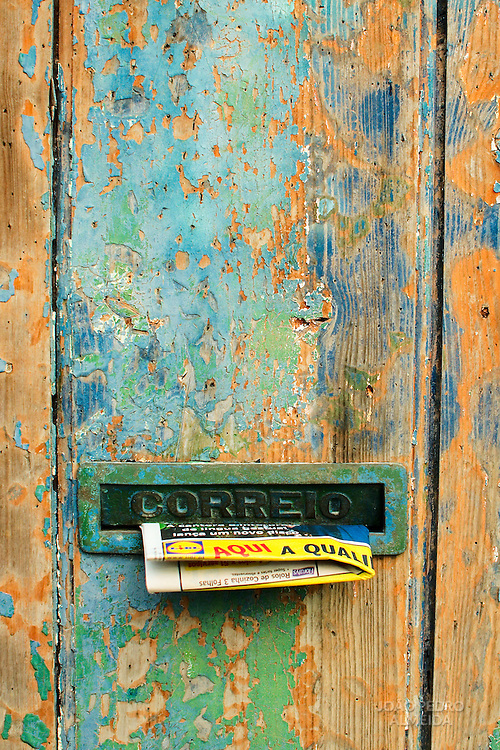 Advertising panflet on a mailbox of Alfama house
