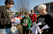 (from left) Michael Andrews, 15, of Westlake, Ohio, and his brother Nathan, 11, check their bus reservations before saying goodbye to their sister, Kristen, an undecided freshman, on Sunday, February 8, 2009, in the back of the Convocation Center as buses prepare to take siblings back to their respective homes.