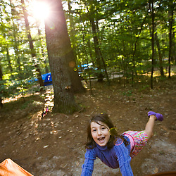 A girl next to her tent in Greenfield State Park in Greenfield, New Hampshire.