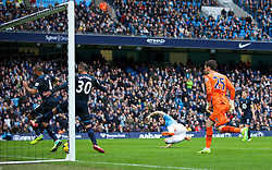 MANCHESTER, ENGLAND - Sunday, November 24, 2013: Manchester City's Alvaro Negredo scores the second goal against Tottenham Hotspur deflecting off Younes Kaboul and Sandro Raniere during the Premiership match at the City of Manchester Stadium. (Pic by David Rawcliffe/Propaganda)