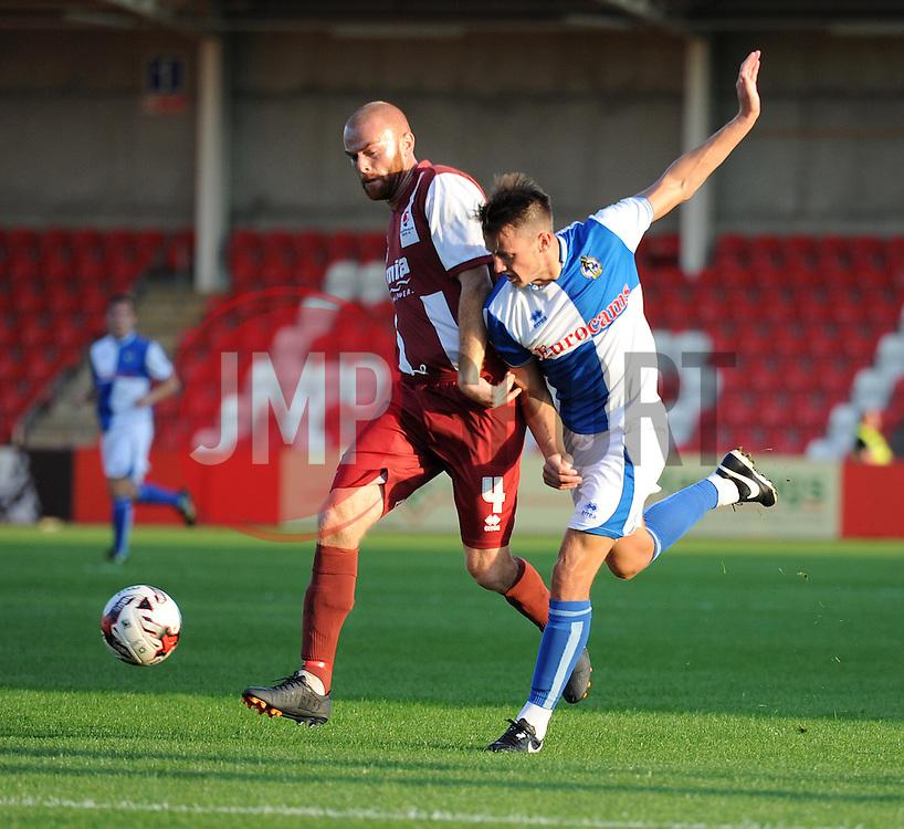 Bristol Rovers' Ollie Clarke battles for the ball with Cheltenham Town's Jason Taylor  - Photo mandatory by-line: Alex James/JMP - Tel: Mobile: 07966 386802 15/07/2014 - SPORT - FOOTBALL - Whaddon Road- Cheltenham  -  Cheltenham Town V Bristol Rovers - preseason