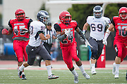 Community College of San Francisco defensive back Deante Fortenberry (24) returns a blocked punt for a touchdown against College of Siskiyous at Community College of San Francisco in San Francisco, Calif., on September 10, 2016. (Stan Olszewski/Special to S.F. Examiner)