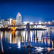 Downtown Cincinnati and the John A. Roebling suspension bridge are seen at dusk from across the Ohio River in Covington, KT.