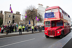 London, UK. 29th January, 2019. A red double-decker bus bearing a People's Vote advertisement and European Union flag passes the Palace of Westminster.