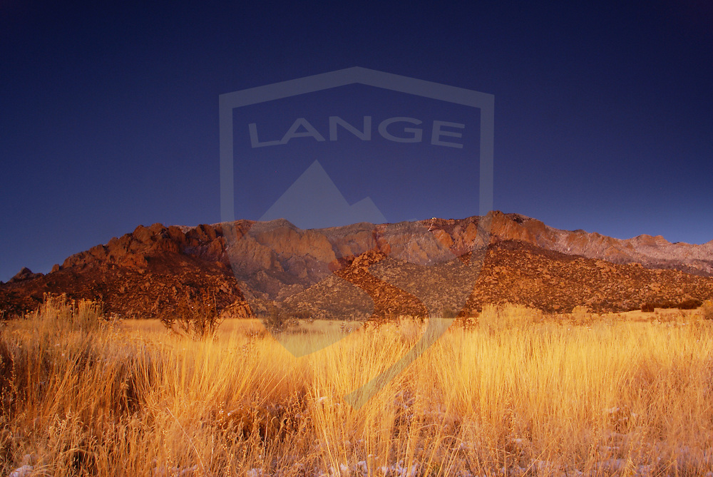travel destinations: the sandia mountains desert twilight landscape glows, albuquerque, new mexico