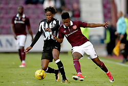 Hearts Ashley Smith-Brown and Newcastle's Ronaldo Aarons battle for the ball during the pre-season friendly at Tynecastle Stadium, Edinburgh.