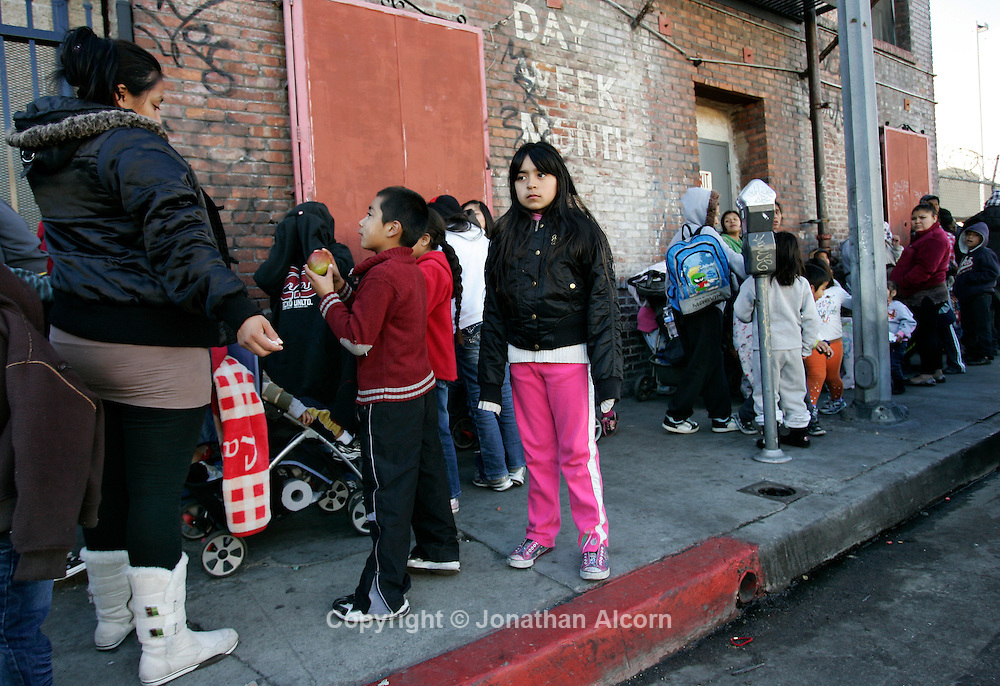 SLUG/USA  People wait in line for the Los Angeles Mission's Christmas meal service and toy giveaway in the skid row section of Los Angeles, California on December 13, 2011. Jonathan Alcorn .