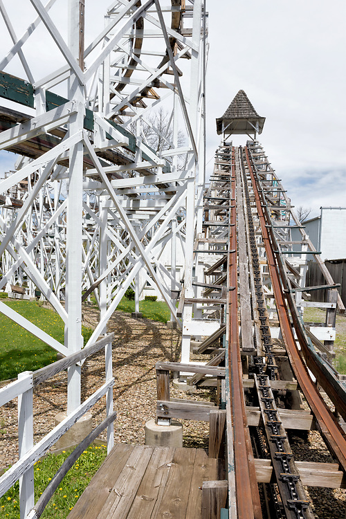 The main incline of the antique wooden roller coaster Leap The Dips at Altoona's Lakemont Park, a very old fashioned classic amusement park ride whose rails and cars still make the clickety-clack sounds.