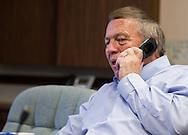 Cedar Falls Mayor Jon Crews talks talks on his cellphone at City Hall in Cedar Falls, Iowa on Tuesday, July 10, 2012.