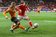Hull City midfielder Josh Bowler (19) and Charlton Athletic defender Ben Purrington (3) during the EFL Sky Bet Championship match between Charlton Athletic and Hull City at The Valley, London, England on 13 December 2019.