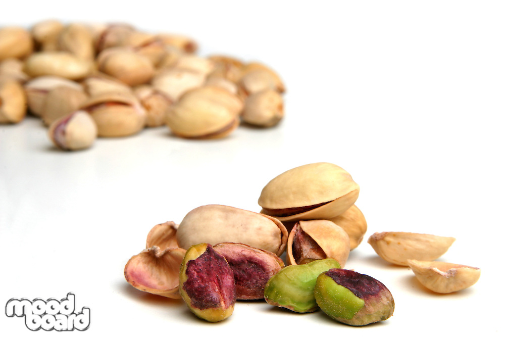 Pistachios on white background - studio shot