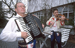 CZECH REPUBLIC MORAVIA BANOV APR98 - Jiri Chovanec (L) and his son Jan tune their instruments in their yard before setting off to play music in their village during traditional Easter celebrations. During Easter, folklore dress, music and mutual visits are part of the customary traditional celebrations in Moravia. jre/Photo by Jiri Rezac<br /> <br /> &copy; Jiri Rezac 1998<br /> <br /> Tel:   +44 (0) 7050 110 417<br /> Email: info@jirirezac.com<br /> Web:   www.jirirezac.com