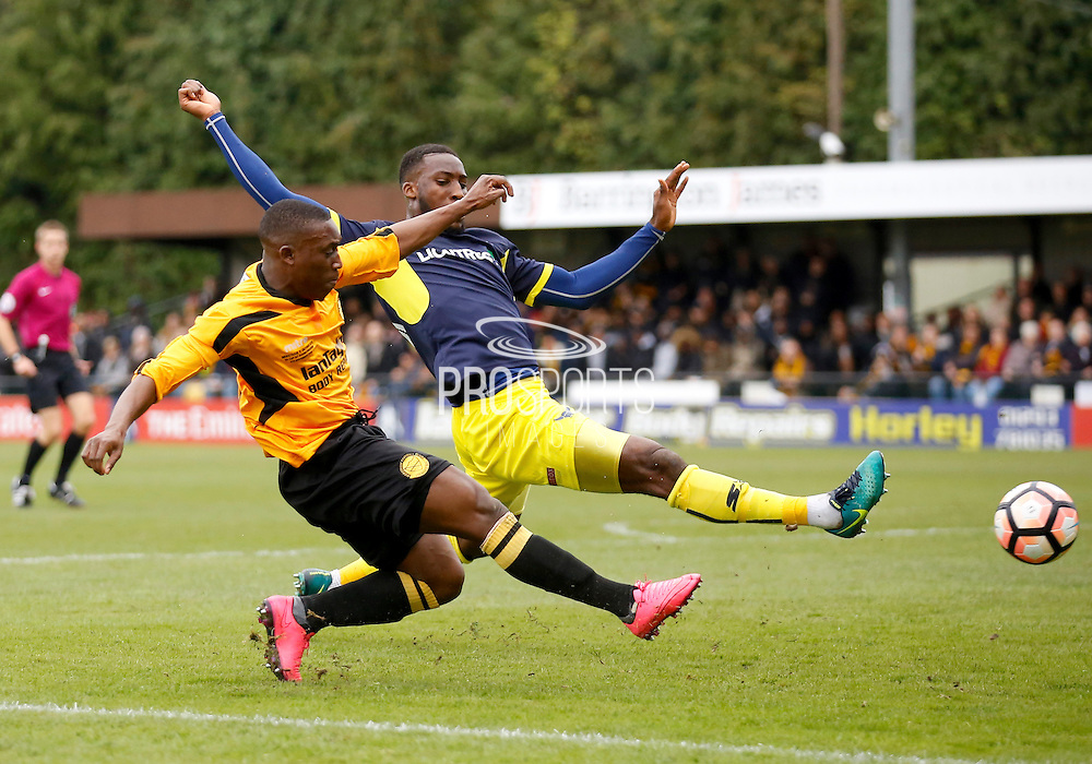 Merstham Midfielder Alex Addai gets a cross in to the box during the FA Cup match between Merstham and Oxford United at Moatside, Merstham, United Kingdom on 5 November 2016. Photo by Andy Walter.
