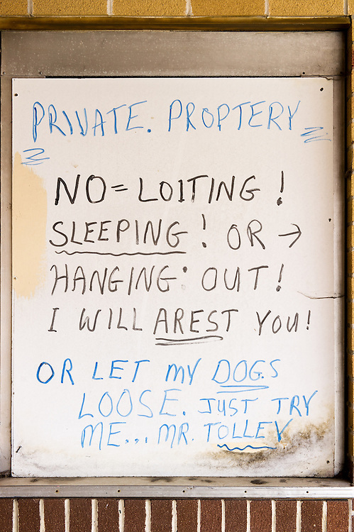 Strange hand written sign with misspelled words posted on a building in Cambridge, Maryland