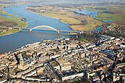 Nederland, Gelderland, Nijmegen, 11-02-2008; overzichsfoto, zicht op de binnenstad met St. Stevenskerk, in het verlengde van de de Waalbrug museum de Valkhof (groene doos); bovendeel van de foto,  rechts van de meanderende rivier, de Ooijpolder: mogelijke toekomstige waterberging bij hoog water; ..luchtfoto (toeslag); aerial photo (additional fee required); .foto Siebe Swart / photo Siebe Swart