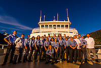 "Crew of the Un-Cruise small cruise ship ""Wilderness Explorer"" in Nakwasina Sound,  Inside Passage, Southeast Alaska USA."