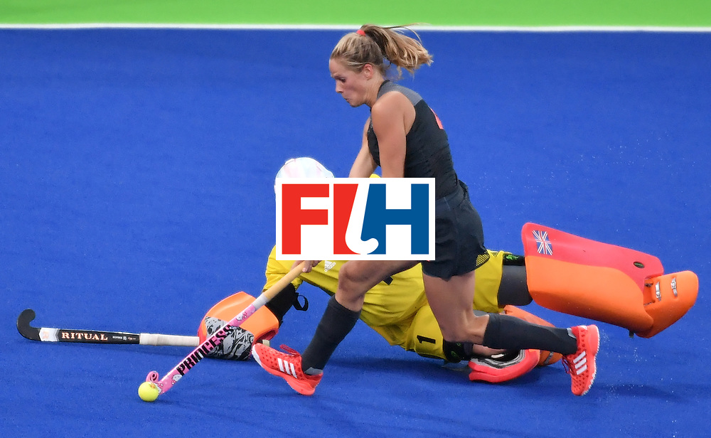 Netherlands' Kitty van Male (top) runs past Britain's goalkeeper Maddie Hinch to score a goal during the women's Gold medal hockey Netherlands vs Britain match of the Rio 2016 Olympics Games at the Olympic Hockey Centre in Rio de Janeiro on August 19, 2016. / AFP / Pascal GUYOT        (Photo credit should read PASCAL GUYOT/AFP/Getty Images)