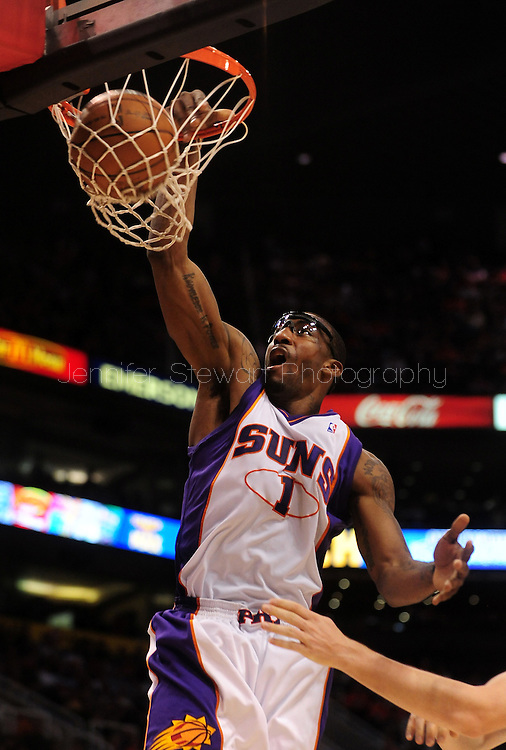 Mar. 14 2010; Phoenix, AZ, USA; Phoenix Suns forward Amare Stoudemire (1) dunks the ball in the second half at the US Airways Center. The Suns defeat the Hornets 120 to 106. Mandatory Credit: Jennifer Stewart-US PRESSWIRE.
