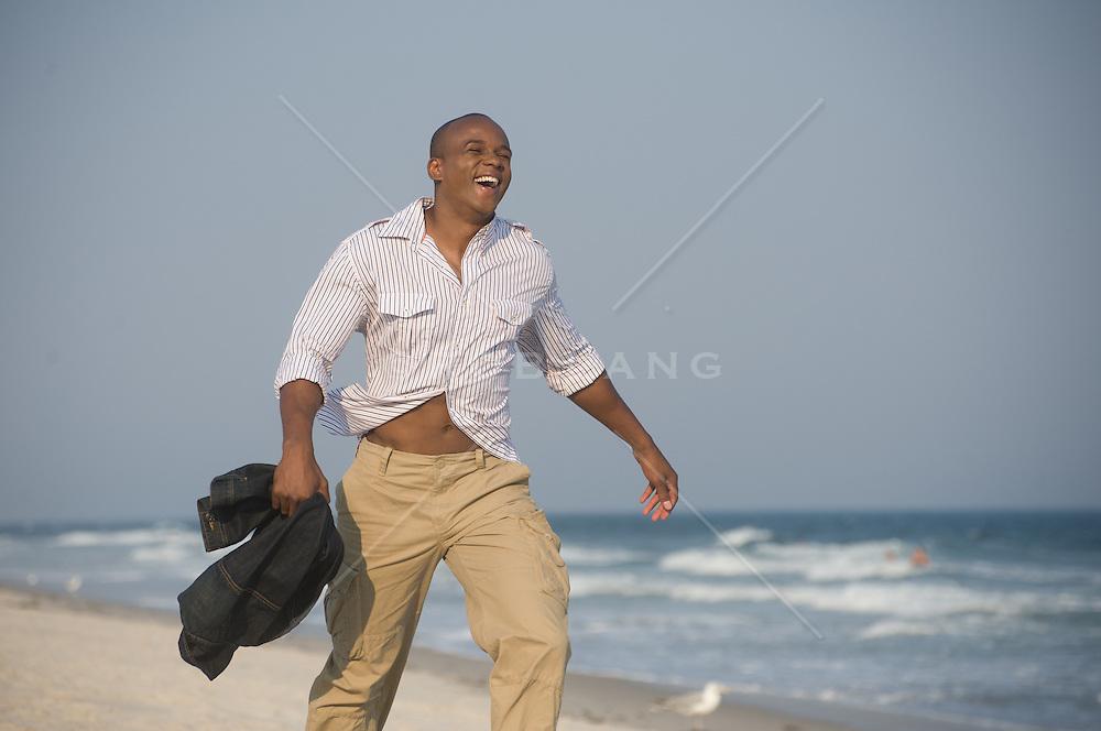 man enjoying a walk on the beach