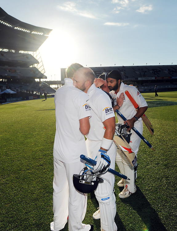 England's Matt Prior, left and Monty Panesar are congratulated by team mates as the match was drawn with New Zealand on the fifth day of the 3rd international cricket test, Eden Park, Auckland, New Zealand, Tuesday, March 26, 2013. Credit:SNPA / Ross Setford