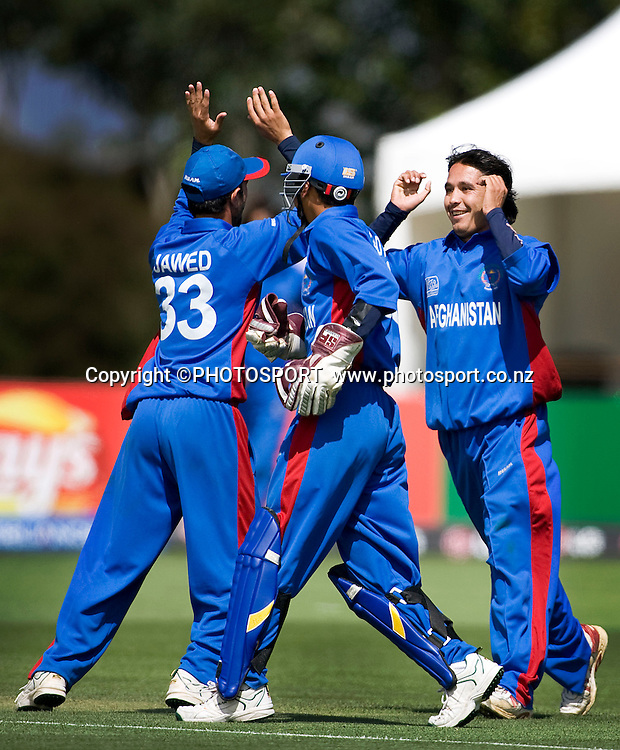 Afghanistan bowler/captain Shir Mohammad Shirzai celebrates his wicket of Kannaur Rahul with catcher Javed Ahmadi (33) and wicket keeper Murad Ali. India v Afghanistan, U19 Cricket World Cup group stage match, Bert Sutcliffe Oval,  Friday 15 January 2010. Photo : Joseph Johnson/PHOTOSPORT