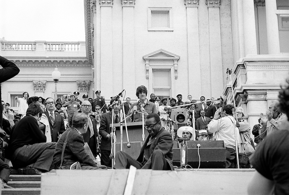On April 22, 1971, Vietnam veteran Lt. John Kerry became the first Vietnam veteran to testify before Congress about the war, when he appeared before a Senate committee hearing on proposals relating to ending the war.<br /> Kerry is shown here speaking on the U.S. Capitol steps the day after his testimony - April 23, 1971 - as he participated in a demonstration with thousands of other veterans in which he and other veterans threw their medals and ribbons over a fence erected at the front steps of the United States Capitol building to dramatize their opposition to the war. - To license this image, click on the shopping cart below -