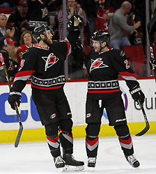 March 3, 2017 - Raleigh, NC, USA - The Canes Lee Stempniak (21) celebrates his goal with Jaccob Slavin (74) during the first period of an NHL game played between the Carolina Hurricanes and the Arizona Coyotes at PNC Arena on March 3, 2017 in Raleigh, N.C. (Credit Image: © Chris Seward/TNS via ZUMA Wire)
