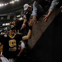 Jan 24, 2010; New Orleans, LA, USA; New Orleans Saints quarterback Drew Brees (9) celebrates with fans following a victory over the Minnesota Vikings in overtime of the 2010 NFC Championship game at the Louisiana Superdome. Mandatory Credit: Derick E. Hingle-US PRESSWIRE