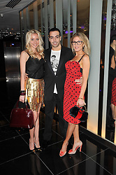 Left to right, NOELLE RENO, MOHAMMED ALTURKI and HOFIT GOLAN at a party to celebrate the 15th birthday of Vogue.com held at W Hotel, Leicester Square, London W1 on 17th February 2011.