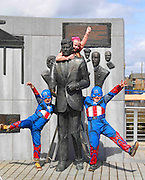 """21/04/2013. REPRO FREE. JFK 50 Lineup. Pictured in New Ross, Co. Wexford at the announcement of the schedule of events for the JFK50 'Homecoming' celebrations on June 22 were Capt. America's Conor Kwinkelenberg, age 6 and Jake Cullen, age 7 with Peig Waters, age 7 at the John F. Kennedy Statue. For further details on the June 22 events see www.JFK50Ireland.com. Picture: Patrick Browne<br /> <br /> International Line-up Announced for JFK50 Celebrations<br /> <br /> The stage line-up for celebrations in New Ross in county Wexford for 'The Homecoming' on June 22 one of the major celebratory dates of the JFK50 year was announced in New Ross this morning (Monday, April 22) and it features some of the model county's best known model citizens.<br /> <br /> Keeping the show on the road and taking the role of MC and host on stage for the afternoon of June 22 will be proud Wexford ambassador Anne Doyle.  The journalist, presenter and former RTE newsreader will take to the stage on New Ross Quayside and welcome visitors to Wexford as well as introduce the formidable line-up, which will include the critically acclaimed award winning author and Wexford ambassador Colm Toibin who will recite from the stage.  Anne will be assisted by George Hook, well-known broadcaster, TV critic and Kennedy fan.<br /> <br /> International singer and Wexford ambassador Michael Londra who was voted the best Tenor at the 2012 Irish Music Awards and is currently wowing audiences with his tour across the U.S. will preform a song he has written especially for the event with Grammy award winning songwriter Marcus Hummon.<br /> <br /> Commenting on his attendance and upcoming performance Michael said, """"I was born a few years after JFK visited but my earliest memories of Wexford are that no matter where I went, in every house, there was a picture of him on every parlor wall, usually with Bobby and Pope John 23rd. All I knew, as a kid was that he wasAmerican and I wanted to go there. He has always represen"""