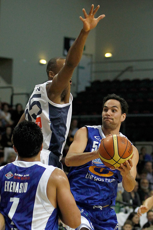 Wellington Saints guard Troy Mclean, right, evaluates his options as he shelters under the Nelson Giants defense in the National Basketball League game, TSB Bank Arena, Wellington, New Zealand, Friday, April 13, 2012. Credit: SNPA/Dean Pemberton.