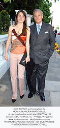 LORD ROMSEY and his daughter the HON.ALEXANDRA KNATCHBULL, at a party in London on 6th July 2004.PWW 138