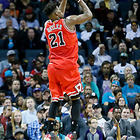 03 November 2015: Chicago Bulls guard Jimmy Butler (21) takes a jump shot during the Charlotte Hornets  130-105 victory over the Chicago Bulls, at the Time Warner Cable Arena, in Charlotte, North Carolina, USA.