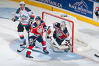 KELOWNA, CANADA - MARCH 27: Riley Hillis #3 stands in front of Eric Comrie #1 of Tri-City Americans on March 27, 2015 at Prospera Place in Kelowna, British Columbia, Canada.  (Photo by Marissa Baecker/Shoot the Breeze)  *** Local Caption *** Riley Hilli; Eric Comrie;