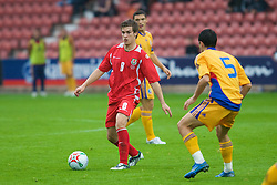 WREXHAM, WALES - Wednesday, August 20, 2008: Wales' Aaron Ramsey in action against Romania during the UEFA Under 21 European Championship Qualifying Group 10 match at the Racecourse Ground. (Photo by David Tickle/Propaganda)