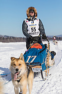 Musher Matt Failor competing in the 45rd Iditarod Trail Sled Dog Race on the Chena River after leaving the restart in Fairbanks in Interior Alaska.  Afternoon. Winter.