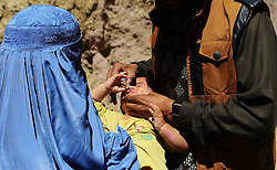 60393044 <br /> An Afghan health worker gives polio vaccine to a child in Herat province, western Afghanistan, on Aug. 26, 2013. Afghanistan launched a three-day nationwide polio vaccination in order to immunise children under five years old against polio, Monday August 26, 2013.<br /> Picture by imago / i-Images<br /> UK ONLY