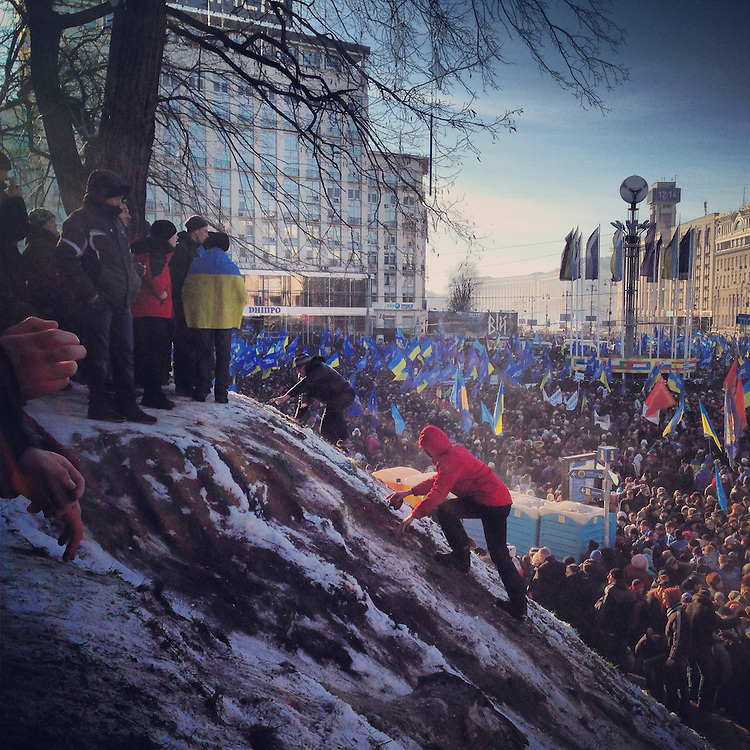 People scale a slippery, snowy hill to escape the crowd at the pro-government Party of Regions rally just up the street from the #euromaidan, Dec. 14, 2013. #євромайдан #київ #україна #kiev #ukraine #primecollective