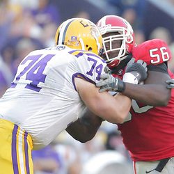 25 October 2008:  Georgia defensive tackle Geno Atkins (56) rushes LSU center Brett Helms (74) during the Georgia Bulldogs 52-38 victory over the LSU Tigers at Tiger Stadium in Baton Rouge, LA.