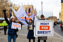 Leave Means Leave protesters encourage passing vehicles to sound their horns as they drive past the Houses of Parliament. London, January 14 2019.