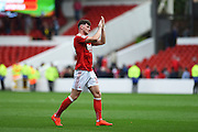 Nottingham Forest midfielder Oliver Burke (35) applauded the Forest fans after winning 4-3 during the EFL Sky Bet Championship match between Nottingham Forest and Wigan Athletic at the City Ground, Nottingham, England on 20 August 2016. Photo by Jon Hobley.