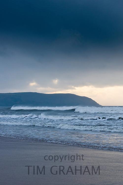 Waves crashing onto the beach at Woolacombe, North Devon, UK
