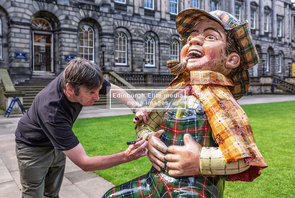 Ian Rankin designed the Oor Wullie statue which was made on his suggestion as he is all for Edinburgh Sick kids fund raising.  Mr Rankin's son has very complex special needs and Mr Rankin senior  developed a very close replationship with them over the past 25 years was they helped looking after his son.   <br /> <br /> The Oor Wullie Bucket trail (200 statues around Scotland) are all fund raising for the various charities.<br /> <br /> Mr Rankin was signing this particular statue to show that this was his design and that he was proud to be associated with the fund raising.  Mr Rankin was brought up reading the Broons and Oor Wullie and was one of the first literatures he ever read.